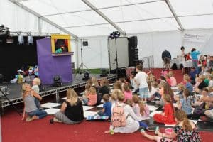 children's entertainers Lincoln - children swatching a puppet show